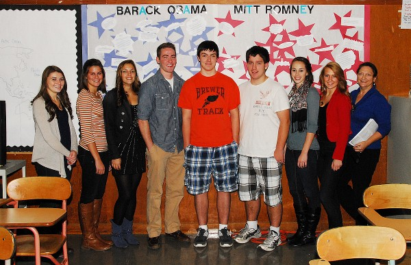 Members of the Close Up group at Brewer High School pose before a board highlighting various quotes from President Barack Obama and Gov. Mitt Romney. While learning about the American political process, the students have worked since last May to raise money to fund a weeklong trip to Washington, D.C. during election week. Group members are (from left) Megan Nickerson, Linsay Brochu, Alexa Grindle, Jacob Caron, Jacob Spaulding, Jarrod Joy, Lindsay Houp, Lauren Gray, and advisor Michele Richens.