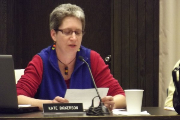 Bangor School Committee member Kate Dickerson reads her resignation statement during the Oct. 9 committee meeting. After reading the statement, she quickly packed up her things and walked out of City Hall.