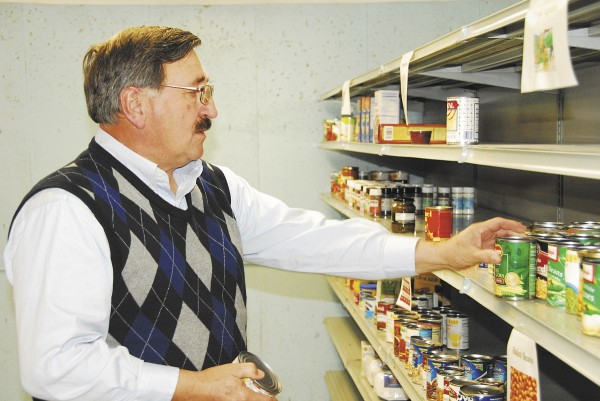 Volunteer Ray Campbell stocks shelves at CHEFS.