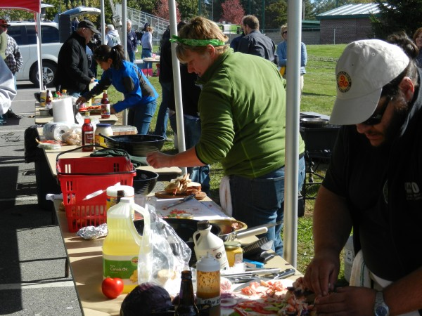 Husson University hosted its first Top Chef Tailgate Cook-off as part of the weekend's Homecoming activities on Saturday afternoon. Kim Smith (second from right) was the eventual winner.