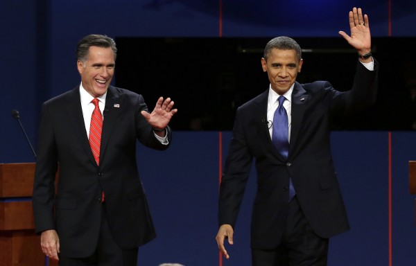 In this Oct. 3, 2012, file photo, Republican presidential candidate Mitt Romney and President Barack Obama wave to the audience during the first presidential debate at the University of Denver in Denver. The sixth &quottown hall&quot style presidential debate will bring Obama and Romney to Hofstra University on New York's Long Island Tuesday, Oct. 16, 2012. They'll take questions from undecided voters selected by Gallup.