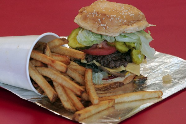 A bacon cheeseburger &quotall the way&quot is served at a Five Guys Burgers and Fries in Fremont, Calif.