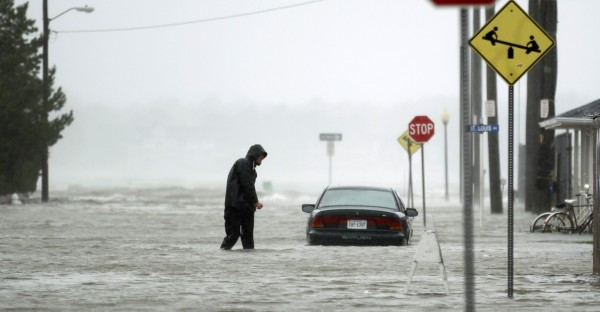 A man wades through a street flooded during Hurricane Sandy in Ocean City, Maryland October 29, 2012. About 50 million people from the Mid-Atlantic to Canada were in the path of the nearly 1,000-mile-wide (1,600-km-wide) storm, which forecasters said could be the largest to hit the mainland in U.S. history.