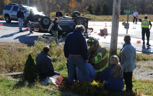 Local police and emergency response personnel attend to a two-vehicle accident that occurred early Tuesday afternoon, Oct. 23, 2012 at the corner of Thorsen Road and Route 1 in Hancock. At least two occupants sustained injuries. One of the vehicles came to a rest on its top.