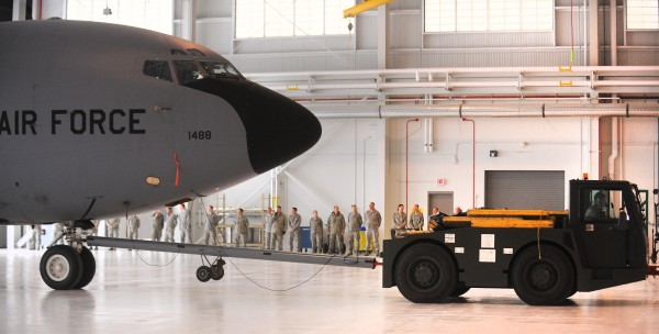 A KC-135R is towed into the new hangar at the 101st Air Refueling Wing base in Bangor Friday. The event marked the official opening of the facility that was completed in August. It is replacing a hangar that has been in use since the 1950's. The ceremony was attended by high-ranking military officials and members of the Maine congressional delegation.