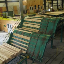 The state-of-the-art Robbins Lumber sawmill grades, trims and sorts wood by computer.