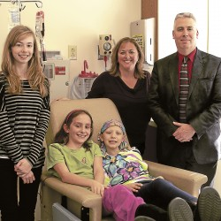When children face cancer, having a warm and inviting space to receive treatments or consult with physicians is important. Alexa Jarvis, an 11-year-old Bangor resident, was diagnosed with an osteosarcoma in November 2011. She receives her treatments at the Children's Cancer and Blood Disorders Clinic at Eastern Maine Medical Center. However, children like Alexa will soon have a new facility to receive treatment that will not only be more convenient, but will offer more options and space. From left to right, Sister Nicole Jarvis, friend Kelly Pellegrino, Alexa Jarvis, Diane Jarvis, and Dr. Robert Jarvis visit during one of Alexa's treatments at EMMC.