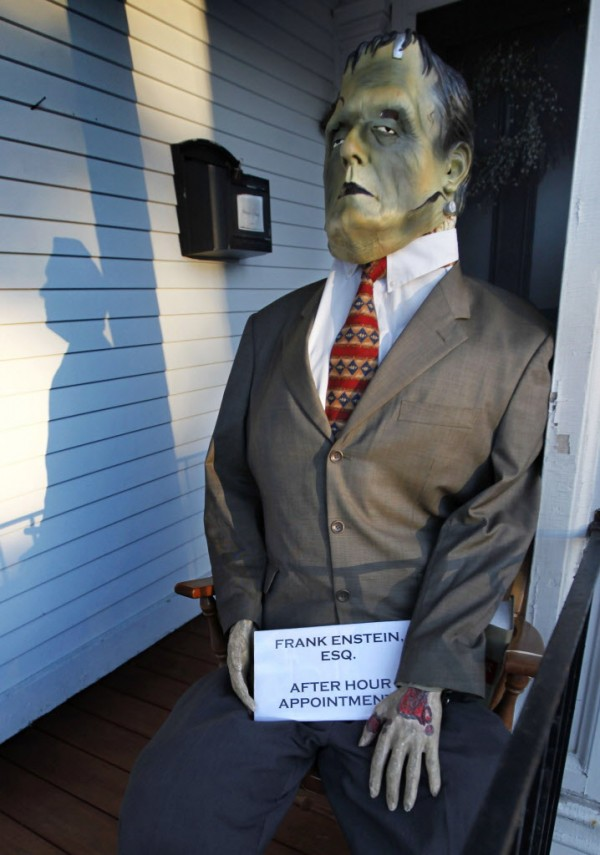 Frank Enstein Esq., sits on a porch outside the Shepard and Read Law Office in Kennebunk.