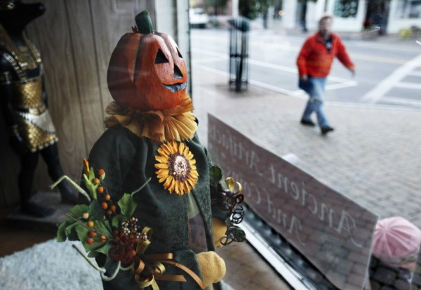 A Halloween decoration is displayed in the window at Wills Copy Center in Kennebunk.