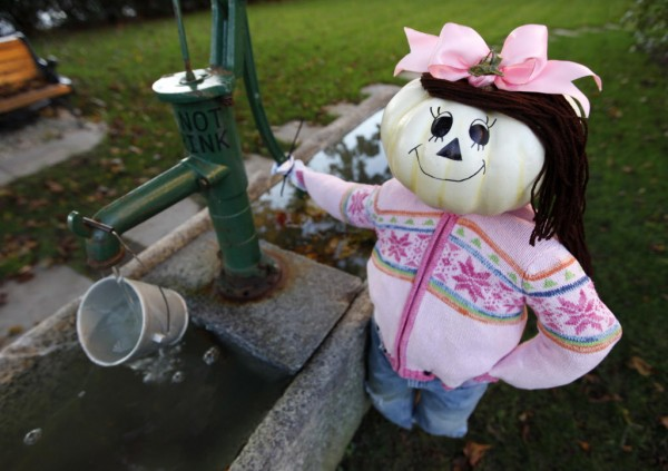 Jill fetches a pail of water in front of the local water utility company on Main Street in Kennebunk.