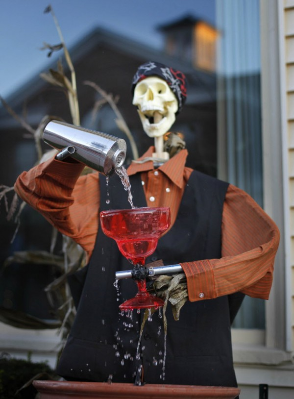 A skeleton bartender overpours a drink outside the Kennebunk Inn on Main Street.