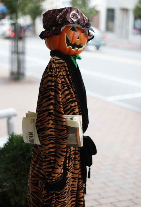 A Halloween character appears to be taking a look up Main Street after picking up her morning paper outside the Fresh Start Consignment clothing store in Kennebunk.
