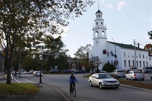 In this Oct. 12, 2012, file photo, a Unitarian Universalist church dominates one end of downtown Kennebunk, Maine. The New England coastal town has grown weary of its 15 minutes of fame following the Zumba prostitution scandal.