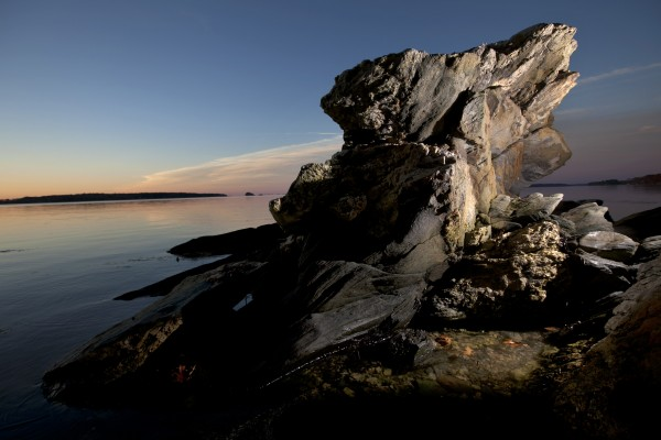 A rock formation overlooks Casco Bay at Wolfe's Neck Woods State Park in Freeport.