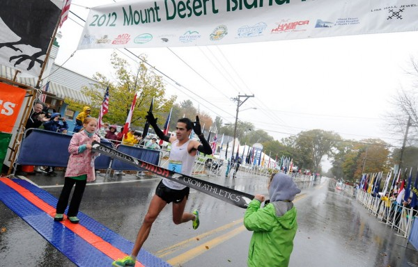 Louie Luchini of Ellsworth breaks the finish line tape of the Mount Desert Island Marathon in record time Sunday morning, Oct. 14, 2012. The scenic 26.2 mile road race starts in Bar Harbor and finishes in Southwest Harbor.