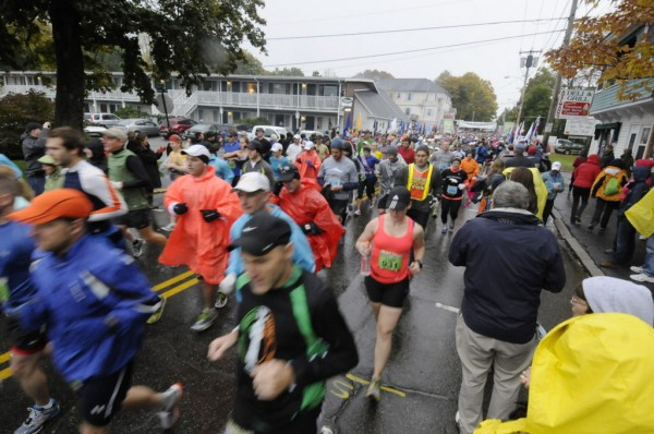 Runners braved the rain as they take off from the Bar Harbor start of the Mount Desert Island Marathon on Sunday morning, Oct. 14, 2012.