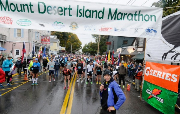 Race director Gary Allen (foreground) looks down Main Street to make sure all systems are go before the start of the Mount Desert Island Marathon on Sunday morning, Oct. 14, 2012.