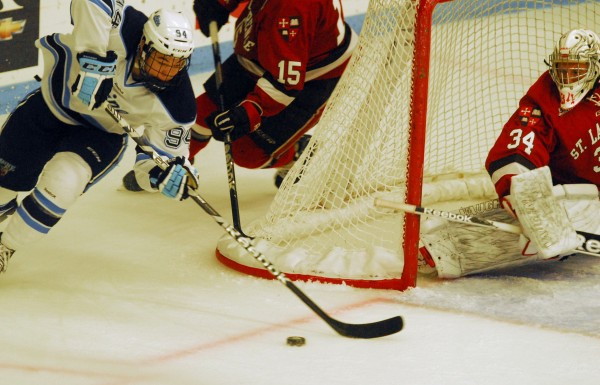 Maine's Devin Shore (94) looks to find some open net ahead of St. Lawrence goalie, Matt Weninger (34) in second-period action at Alfond Arena Saturday, Oct. 20 2012.