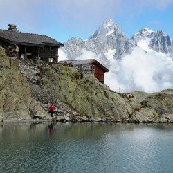 High mountain lake, historic wooded hut, clouds, and high peaks: what more could one want?  Photo by Carey Kish