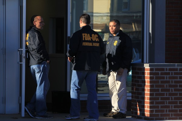 Federal agents investigate the offices of New England Compounding Center in Framingham, Mass., Tuesday, Oct. 16, 2012. The company's steroid medication has been linked to a deadly meningitis outbreak.