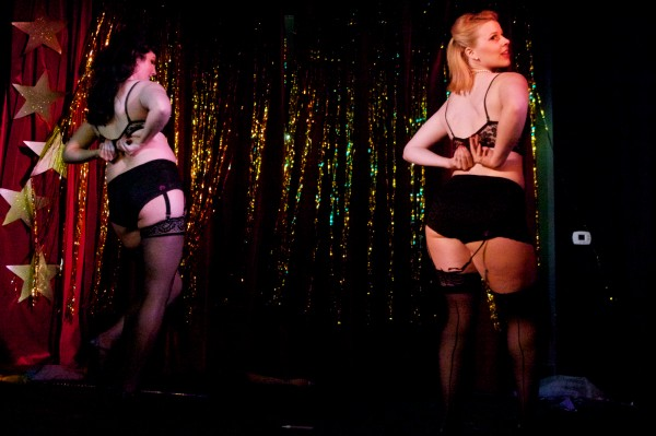 Whistlebait Burlesque partners Vivian Vice (left) and Jolene Divine perform at the Peek-a-boo Review at the Mayo Street Arts Center in Portland this summer.