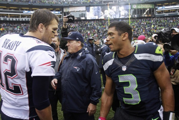 New England Patriots quarterback Tom Brady (left) congratulates Seattle Seahawks quarterback Russell Wilson following their NFL game in Seattle, Oct. 14, 2012.