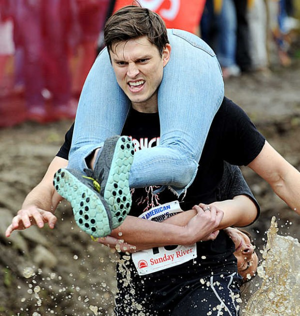 Anne Murray tries to keep her face out of the muddy waters as she is carried by Sean Murray during the 2012 North American Wife Carrying Championship Saturday.  Unlike other women, she was able to stay relatively mud free in the face and the duo placed tenth with a time of 1:07.46.