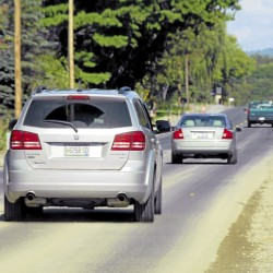 Vehicles eastbound on Main Road North (Route 1A) in Hampden roll onto a section of the road recently paved as part of a 0.7-mile reconstruction project.