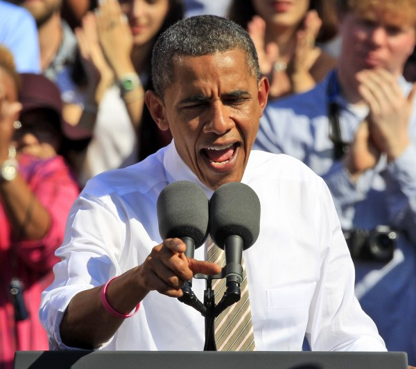 President Barack Obama gestures while speaking during a campaign rally in Byrd park in Richmond, Va., Thursday, Oct. 25, 2012.