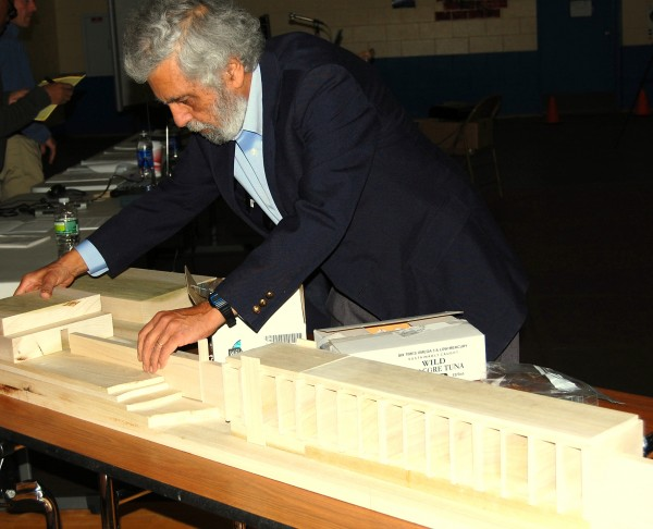 Ramez Atiya, the developer of a proposed $70 million tidal generation project in Washington County, assembles a scale model of the 1,616-foot low dam he envisions stretching across the Pennamaquan River in Pembroke, where the river flows into Cobscook Bay. Atiya used the model Thursday evening, Oct. 25, 2012, to explain the dam's design to about 50 people who attended a public meeting at Pembroke Elementary School. An earlier, outdoor site visit was held at a Pennamaquan River boat ramp Thursday afternoon.