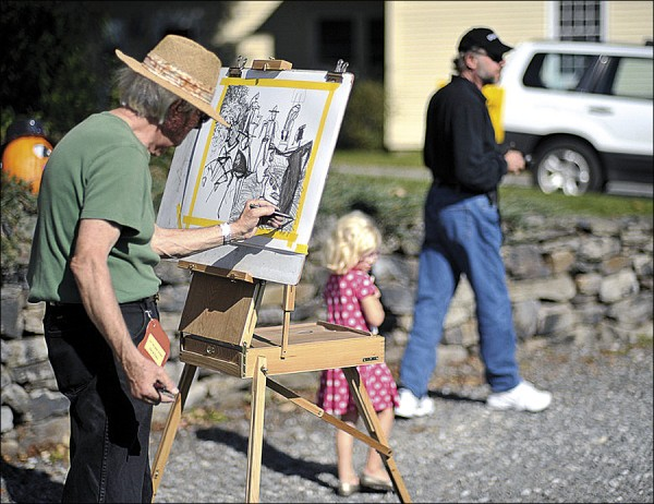 A painter sketches a local scene during the Fling into Fall Celebration in Searsport.