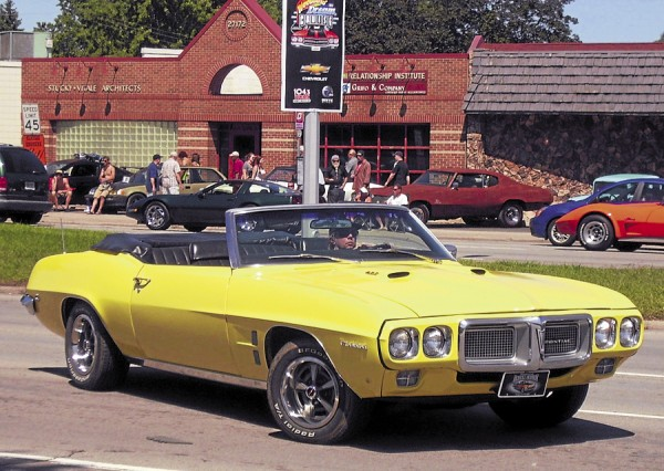 A classic Pontiac Firebird revs its engine as the driver prepares to lay rubber during the Woodward Dream Cruise in Detroit, Mich.