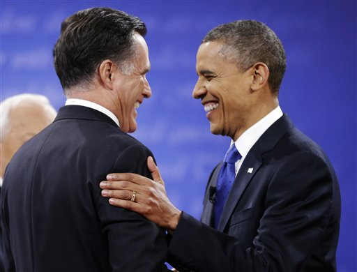 Republican presidential nominee Mitt Romney (left) is greeted by President Barack Obama before the start of the third presidential debate at Lynn University on Monday, Oct. 22, 2012, in Boca Raton, Fla.