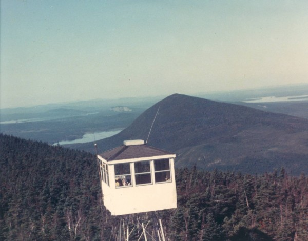 The fire tower on the ridge of Big Spencer Mountain near Kokadjo, Maine, is operational during the summer of 1980, and the &quotlookout&quot or &quotwatchman&quot is working from the sheltered cab.