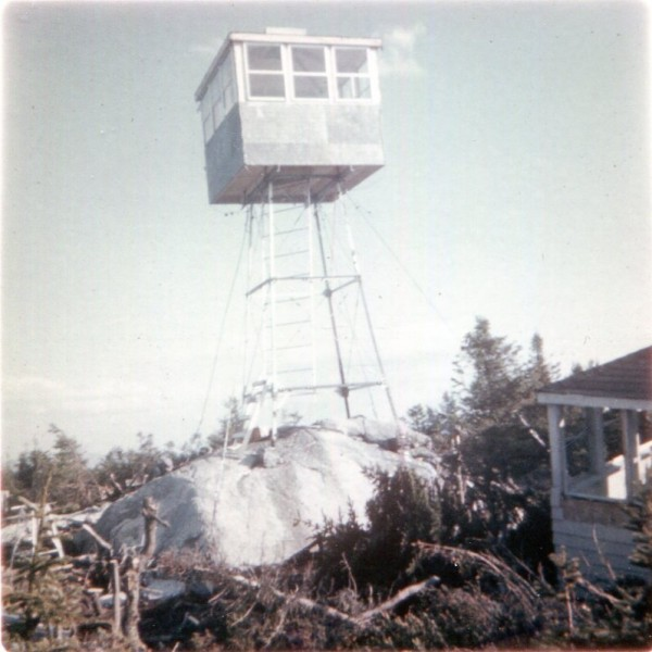 The fire tower located on the ridge of Big Spencer Mountain near Kokadjo, Maine, is operational during the summer of 1967. At the time, the two &quotlookouts&quot or &quotwatchmen&quot were Ed and Dorothy Lambert.