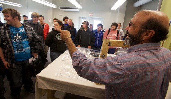 Southern Maine Community College composites professor Andrew Schoenberg explains simple vacuum thermo-forming to Mt. Ararat High School students at the Brunswick campus Wednesday Oct. 17, 2012 during its first STEM conference.