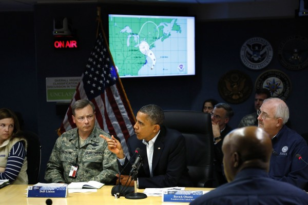 President Barack Obama asks a question during a Federal Emergency Management Agency briefing about Hurricane Sandy, as it threatens the East Coast, at FEMA headquarters in Washington, October 28, 2012. Obama warned on Sunday that Hurricane Sandy was a &quotserious and big storm&quot and called on East Coast residents to heed the orders of state and local officials to protect themselves from its onslaught.
