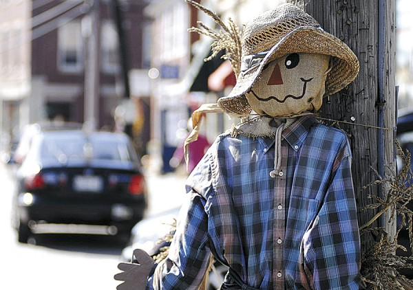 "A scarecrow ""watches"" traffic on Main Street in Searsport during that town's annual Fling into Fall Celebration."