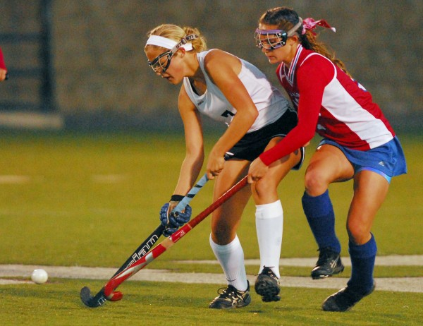 Skowhegan's Mikayia Toth (left) tries to keep the ball from Messalonskee's Kylee Knight during the Eastern Maine Class A field hockey final at Hampden Tuesday, Oct. 23, 2012. Skowhegan won 2-1.