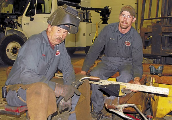 Stanley McDevitt (left) is the chief mechanic for Eliott Jordan & Son of Waltham. His son, Justin McDevitt (right), also works in the shop as a mechanic.