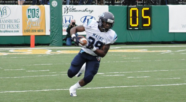 University of Maine running back Rickey Stevens runs for a gain after catching a pass from quarterback Marcus Wasilewski during Saturday's Colonial Athletic Association game at Williamsburg, Va. The Black Bears won 24-10.