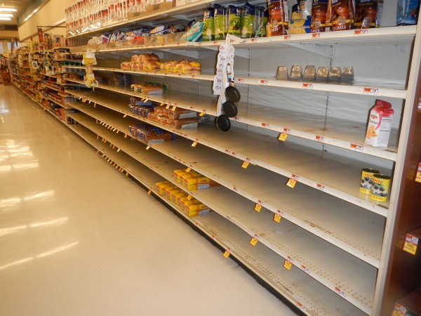 In the path of Hurricane Sandy, Haddonfield King's Highway shops stand prepared on Monday, October 29, 2012. Here, the bread shelf at Acme stands nearly empty.