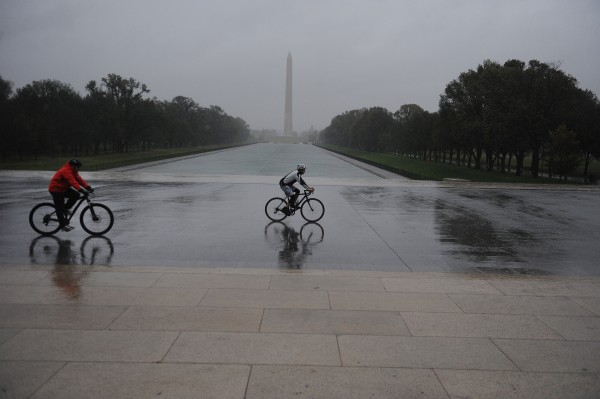 People riding bicycles fight the high winds and rain from Hurricane Sandy, Monday, October 29, 2012, at the Lincoln Memorial in Washington, D.C.