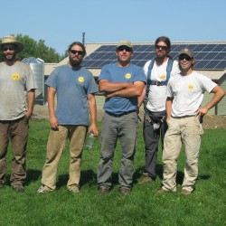 This crew from ReVision Energy in Liberty, ME came to Unity College this September to install 144 solar electric panels on the Library roof at Unity College (shown in the background). Three of the crew are Unity graduates. Left to right: Dennis Rumba, Jared Palmer, Brian Byrne, Matt Wagner and Ryan Herz.