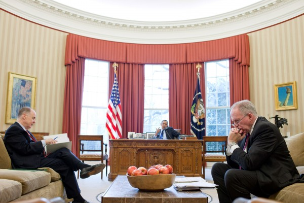 National Security Advisor Tom Donilon, left, and John Brennan, assistant to the president for Homeland Security and Counterterrorism, listen as President Barack Obama talks on the phone in the Oval Office in March 2011.