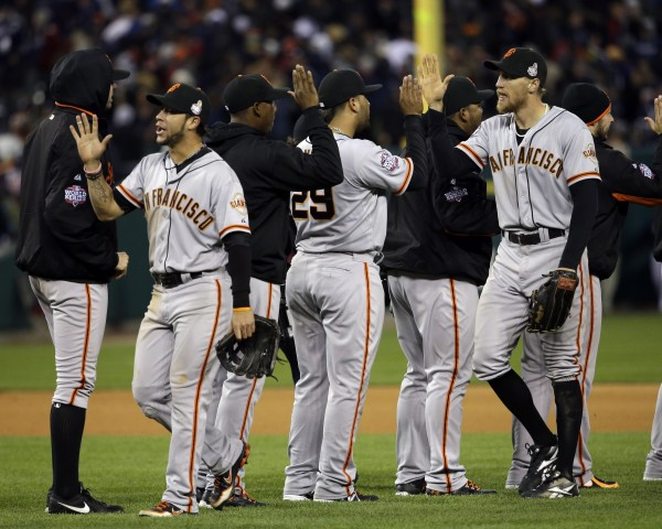 The San Francisco Giants celebrate after Game 3 of baseball's World Series against the Detroit Tigers Saturday, Oct. 27, 2012, in Detroit. The Giants won 2-0 to take a 3-0 lead in the series.