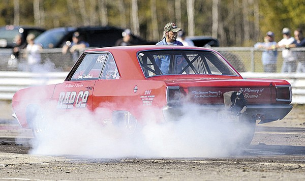 A competitor burns rubber at the starting line during October competition at the Winterport Dragway.