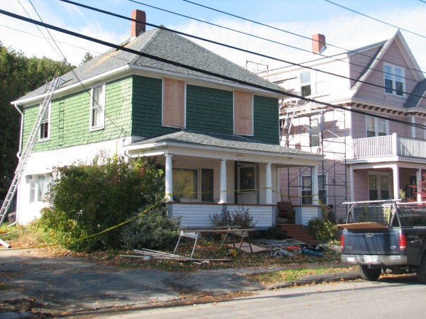 A house at 85 Ledgelawn Avenue in Bar Harbor remained taped off and partially boarded up on Saturday after catching fire the night before. According to a local fire official, the house sustained significant damage but could be repairable.