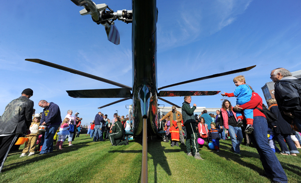 Children and adults check out the Life Flight of Maine helicopter that landed during the Trucks and Treats event at the Lafayette Family Cancer Care of Maine building in Brewer Saturday.