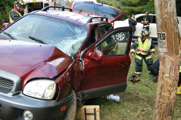 Holden public safety personnel deal with the aftermath of an SUV crash on Clark Hill Road in Holden on Monday, Oct. 1, 2012, in which a local woman suffered serious internal injuries. Alcohol was cited as a factor in the accident, which occurred about 3:30 p.m.